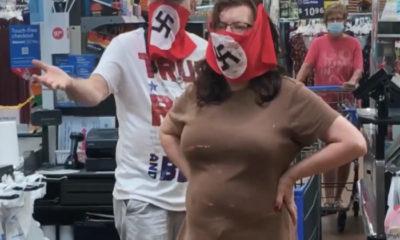 pareja entra a Walmart con mascarillas nazis